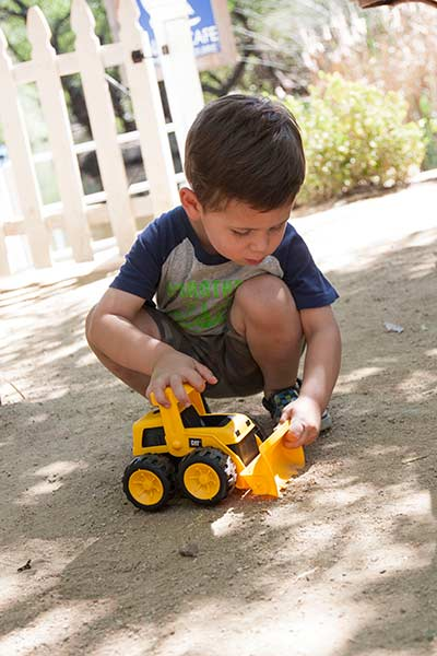 3 year old playing with the Toy State Caterpillar Tough Tracks Bulldozer