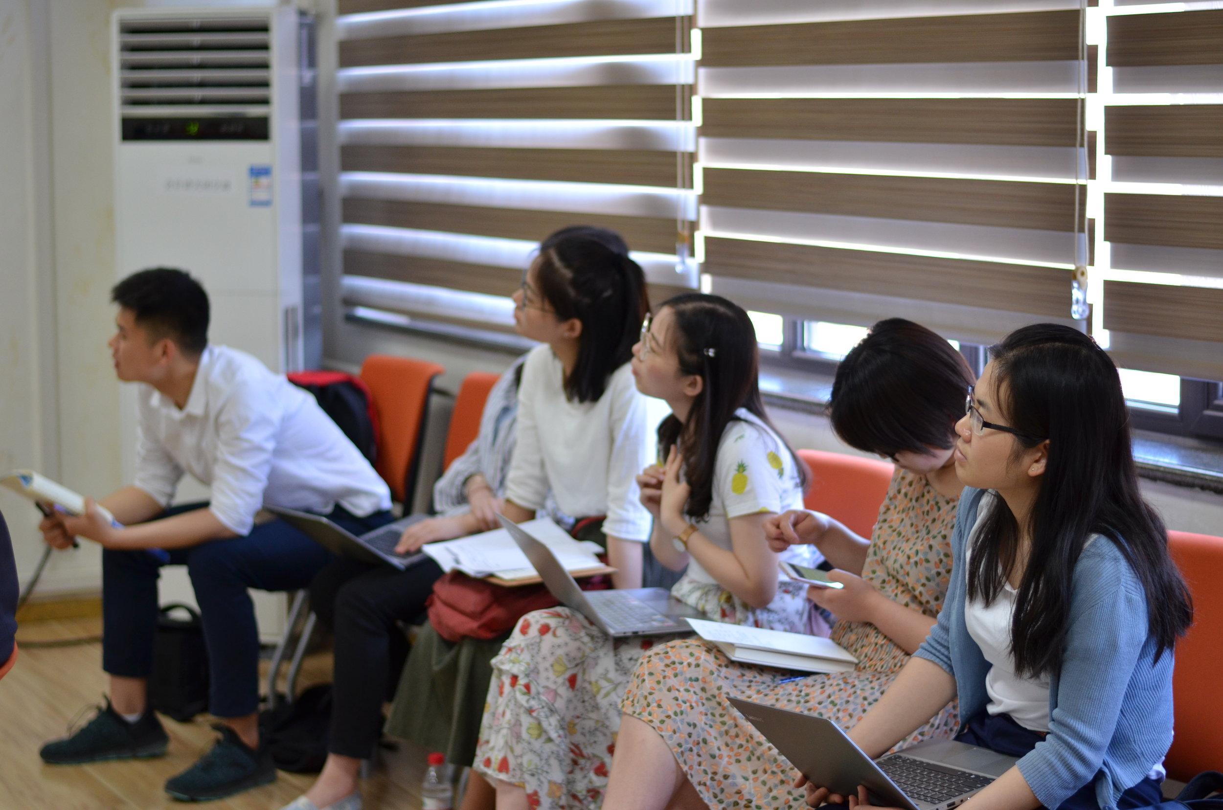 Students listening to presentation at Renmin University