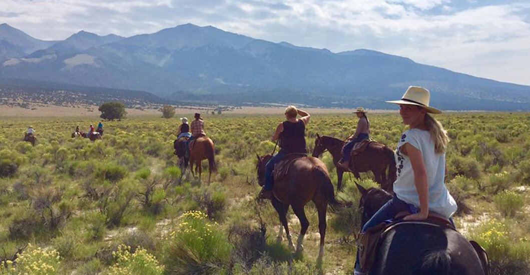 We work hard but make time for a quick (optional) horseback ride. Riding here at Zapata Ranch.