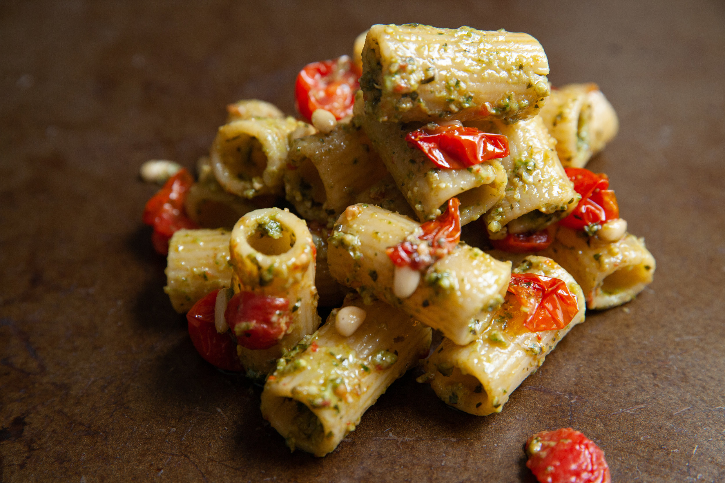 Rigatoni with blistered grape tomatoes, pesto, and pine nuts.