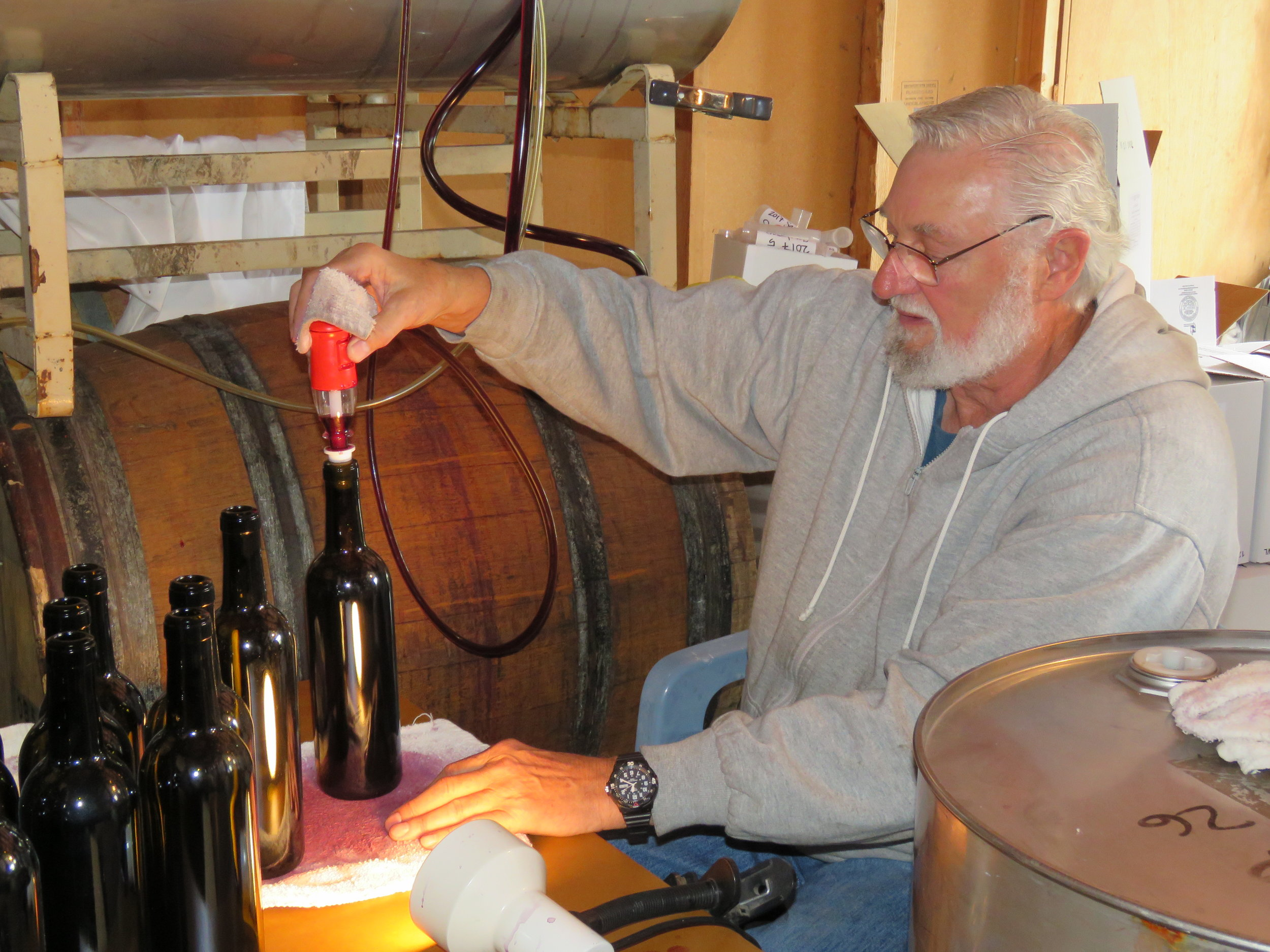 Jay filling the bottles with wine from the barrels