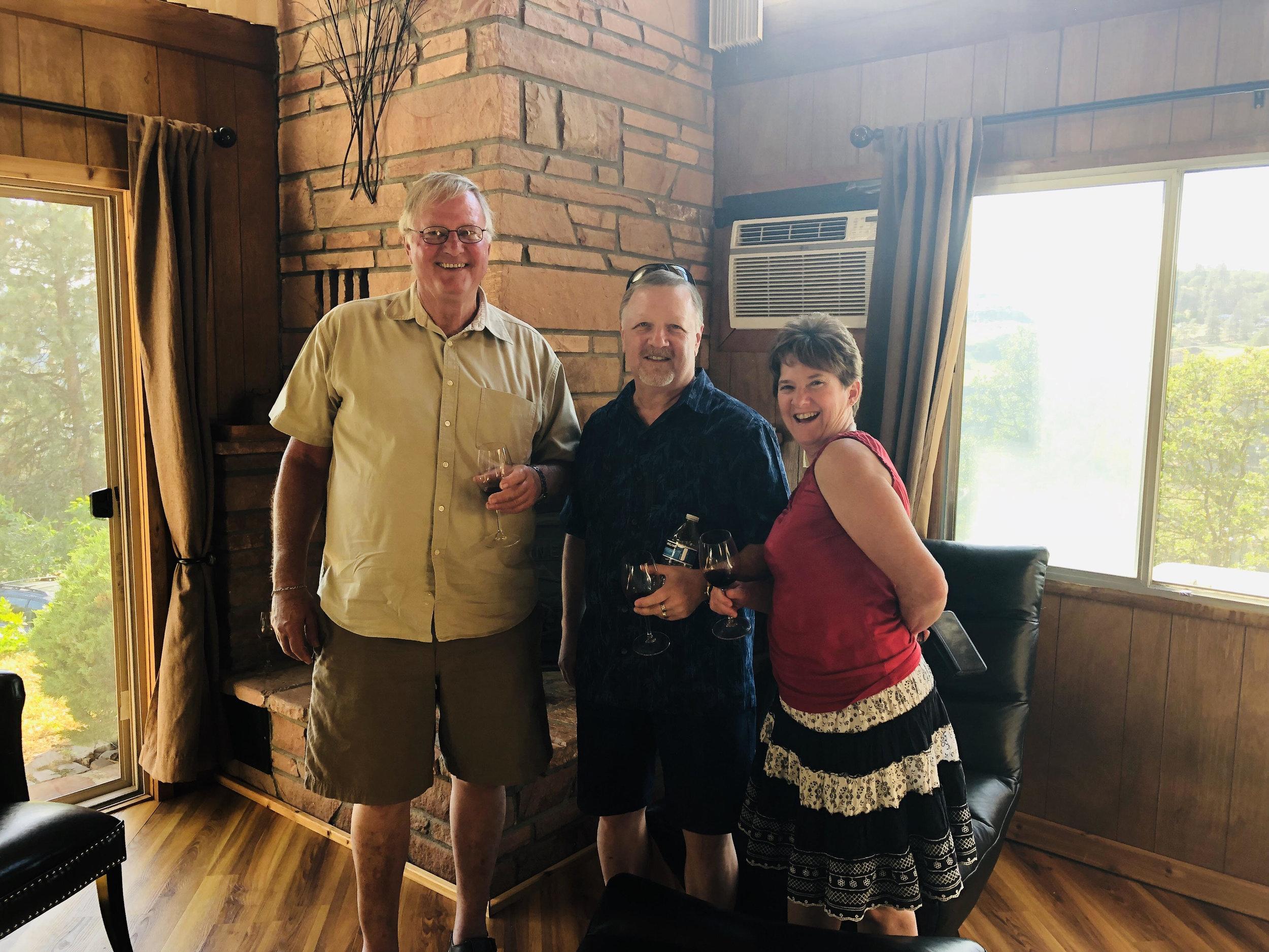 Dad Keith, Gary, and Susan sharing Harley stories and Charbono