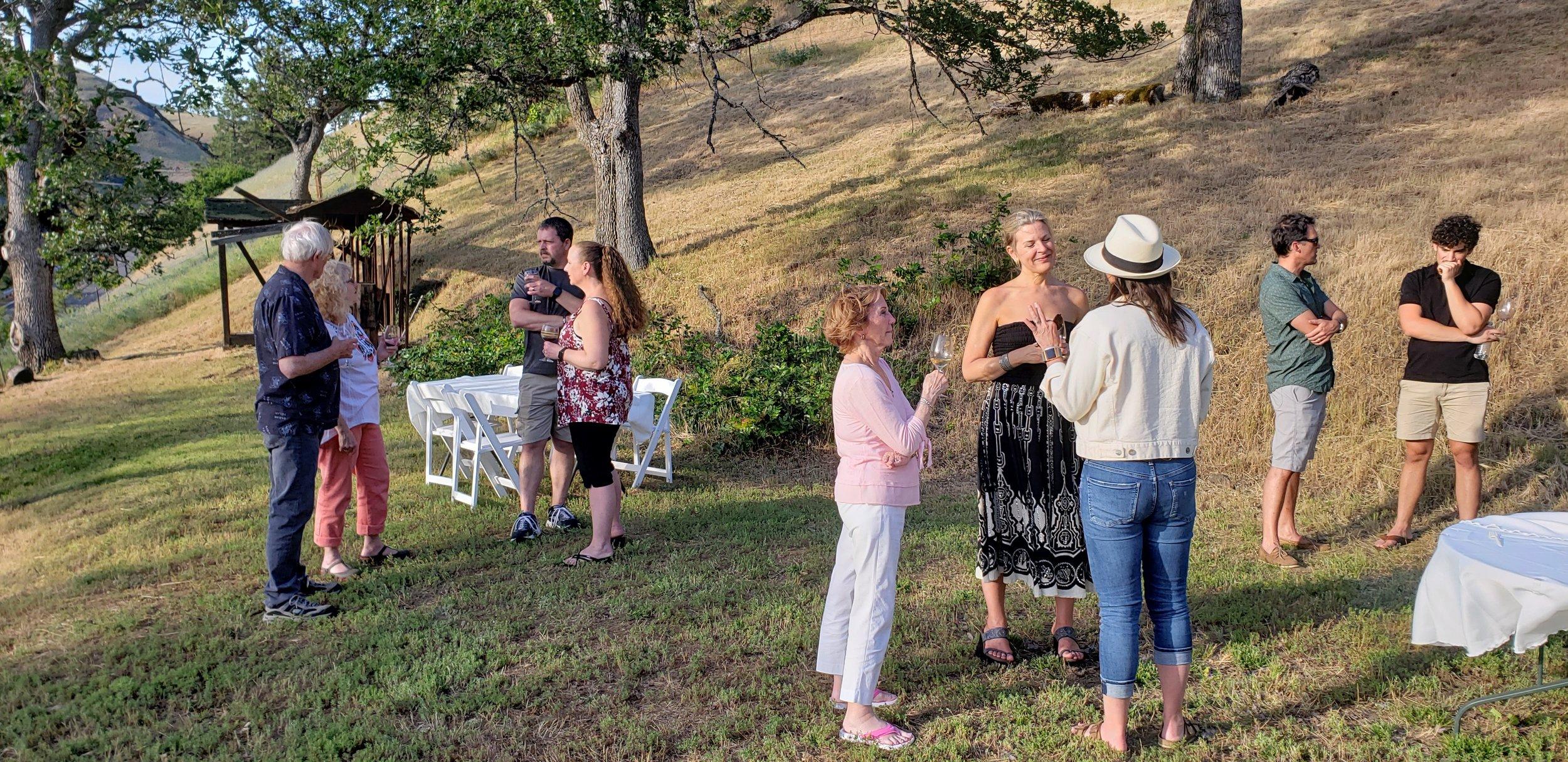 Fellowship members mingling in the yard