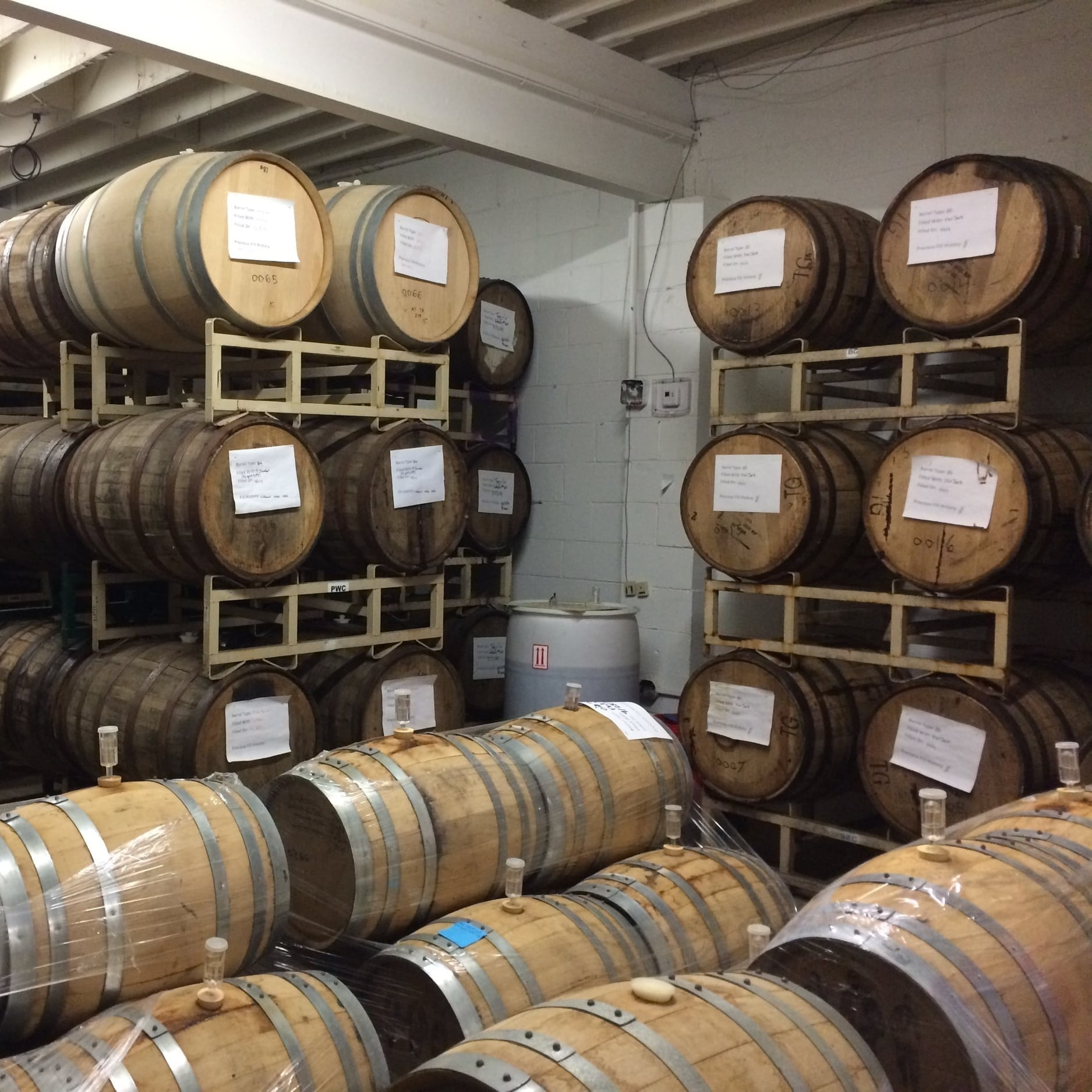 Flat12's cellar houses a variety of barrels like bourbon,  tequila, rum, wine, and port barrels.