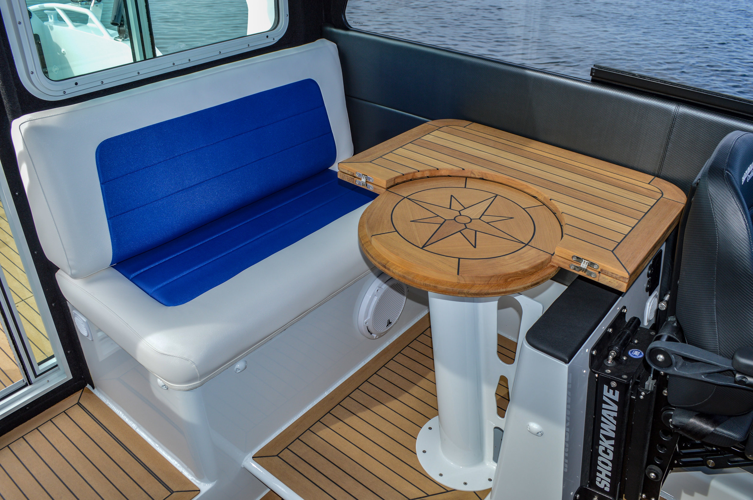 A TABLE FOR TWO - Its beautiful teak table is the center piece of the Yachtlines main cabin. Its smart bi-folding design provides a reservation of space for either entertaining or moving about the cabin.