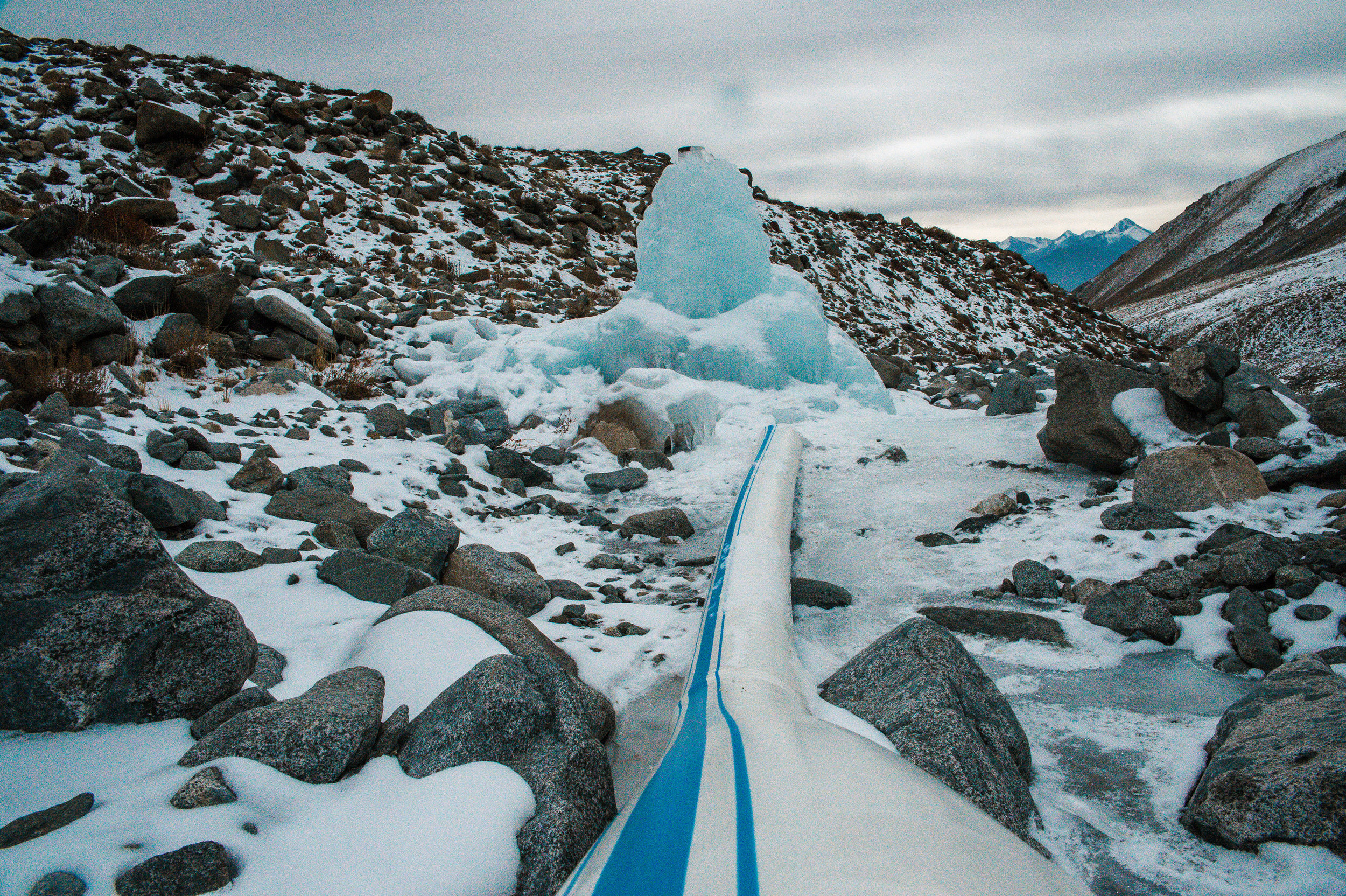 ... To build an ice stupa (artificial glacier) inside a stream, fed only by gravity and naturally gushing water