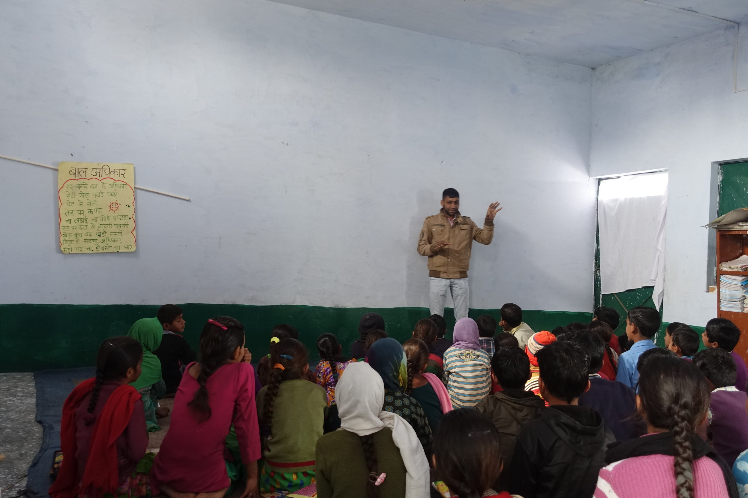 Nature class for young school children led by one of NSI's outreach coordinators, Taukeer.