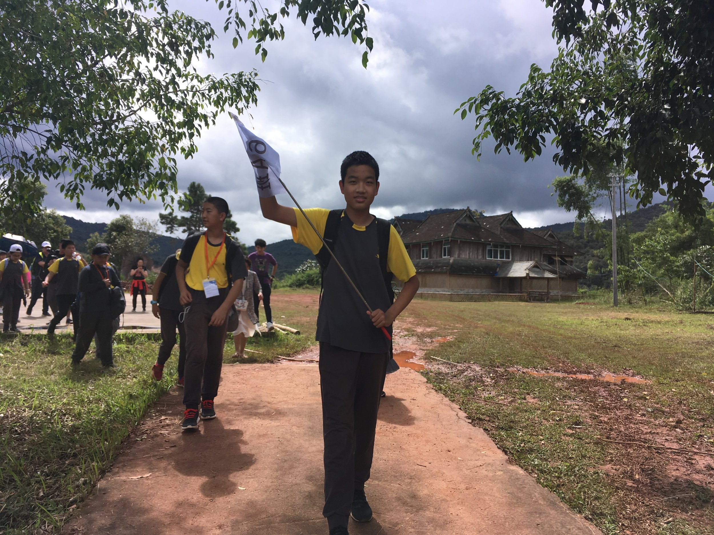 01-5 Students head to village after museum tour.JPG