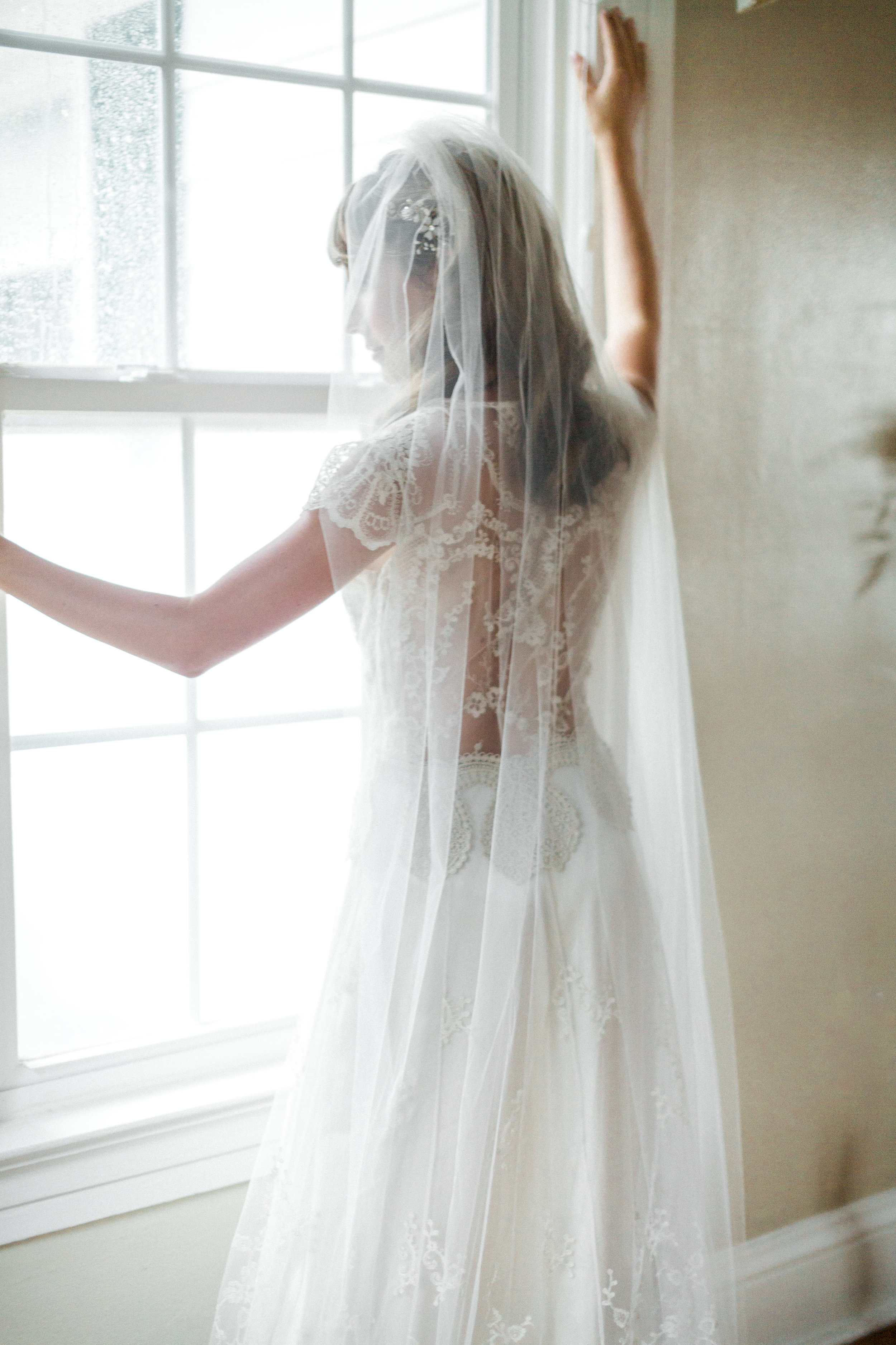 the cypress grove estate house in orlando florida, styled wedding bridal photo in wedding dress with veil