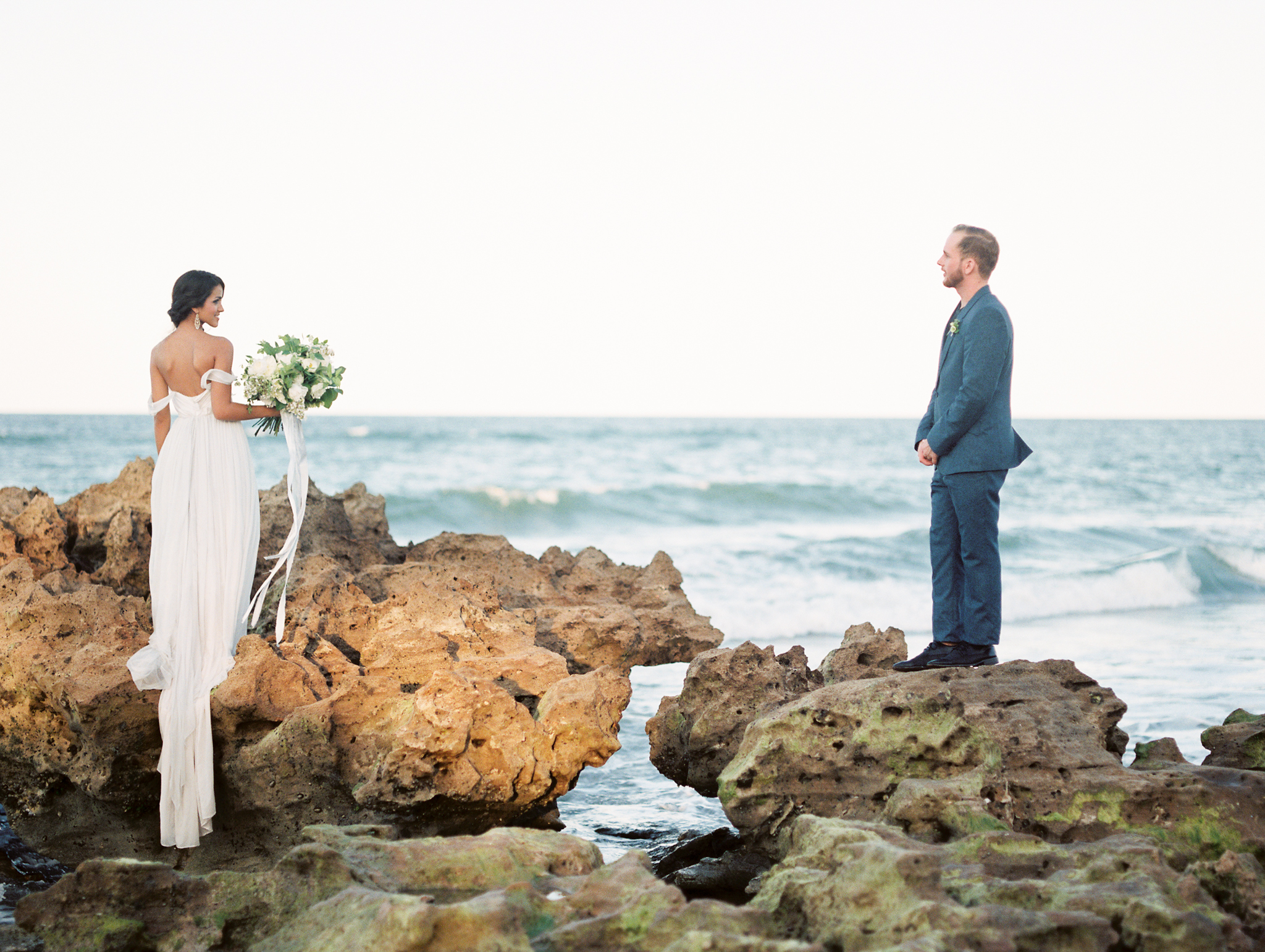 coral cove, jupiter beach FL, palm beach wedding photos, bride and groom on beach rocks