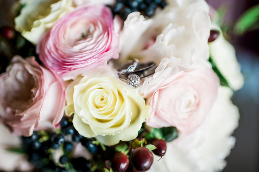 estate on the halifax in daytona beach, port orange fl wedding photos getting ring in flowers photo