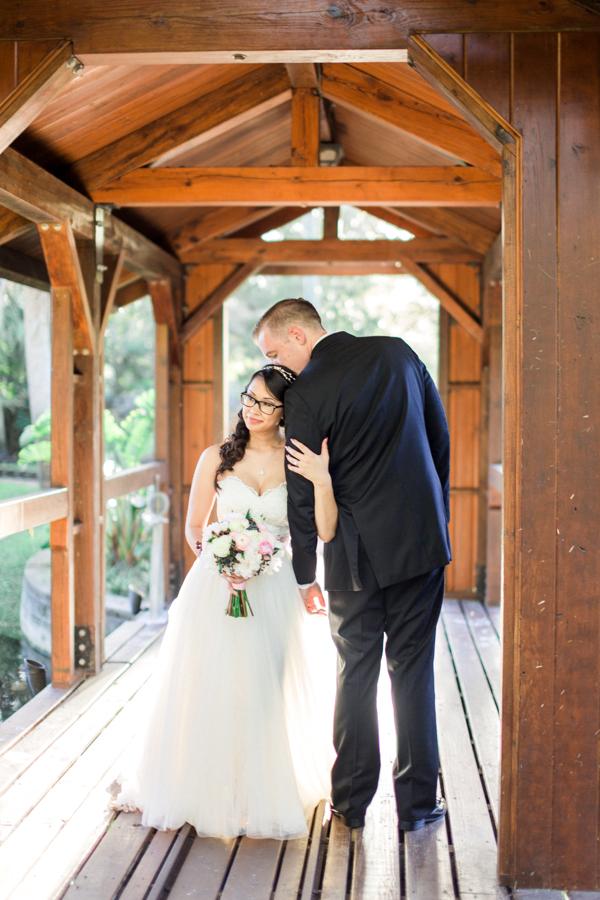 estate on the halifax in daytona beach, port orange fl wedding photos, bride and groom photos on bridge