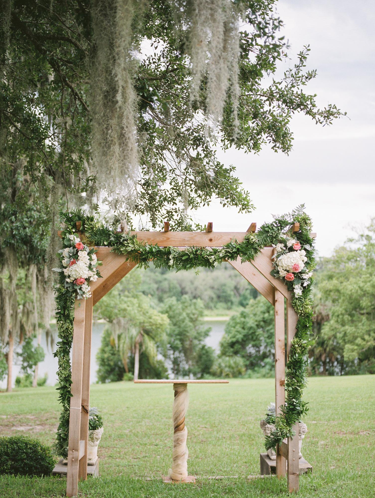 sydonie mansion mount dora orlando fl wedding photos ceremony arch