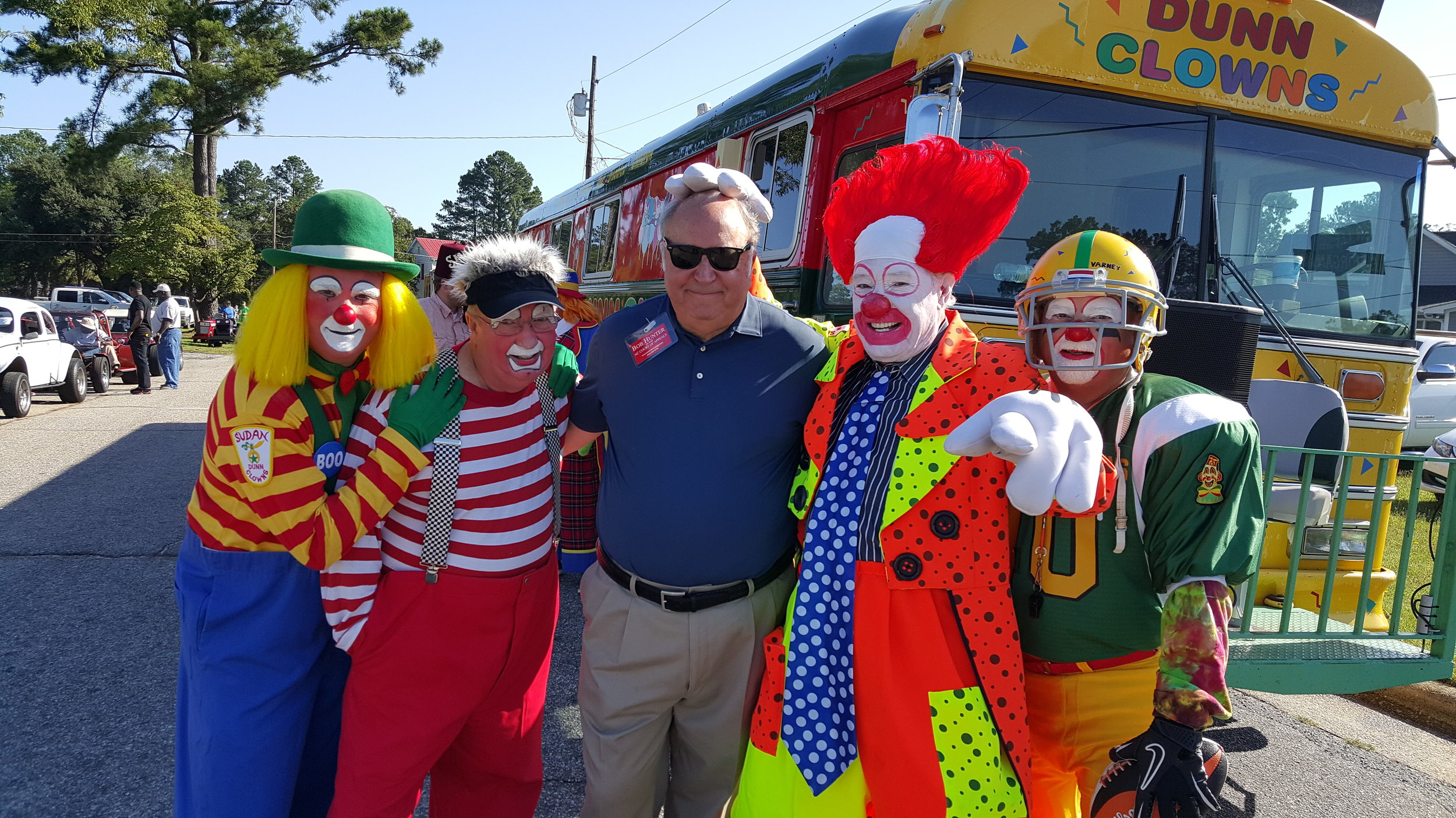 Judge Hunter at Mule Day with clowns from Dunn Shrine Club