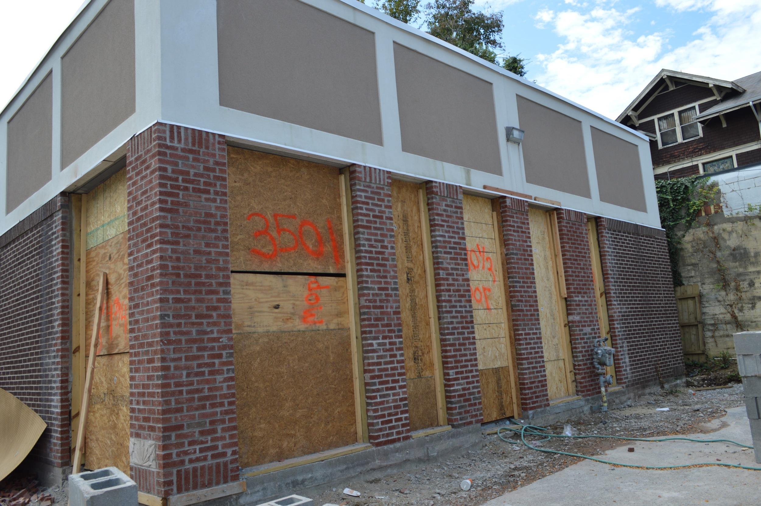 Beginning to open the opaque facade enfronting Erie Avenue.