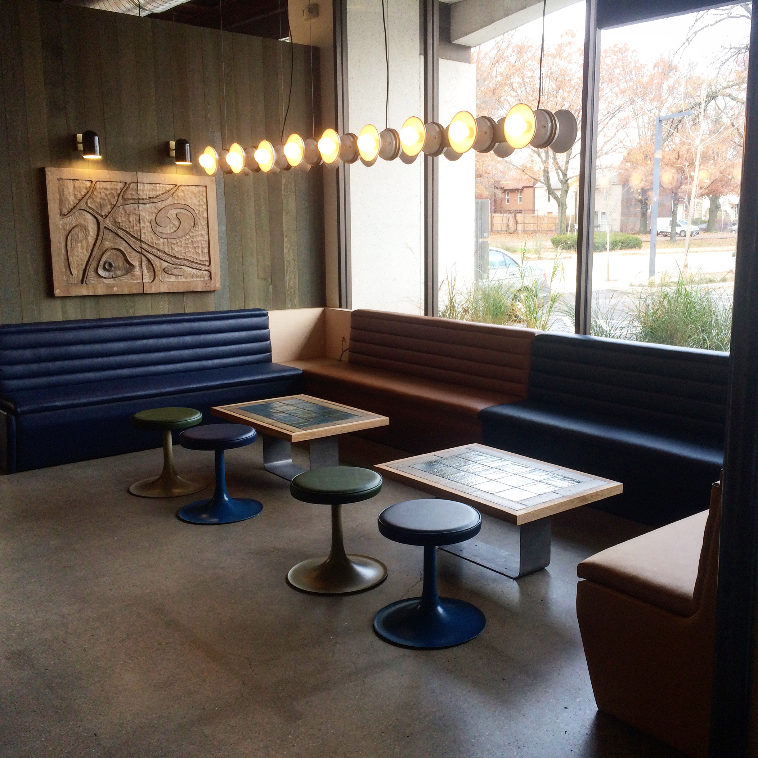 Custom oak dining tables and banquette benches