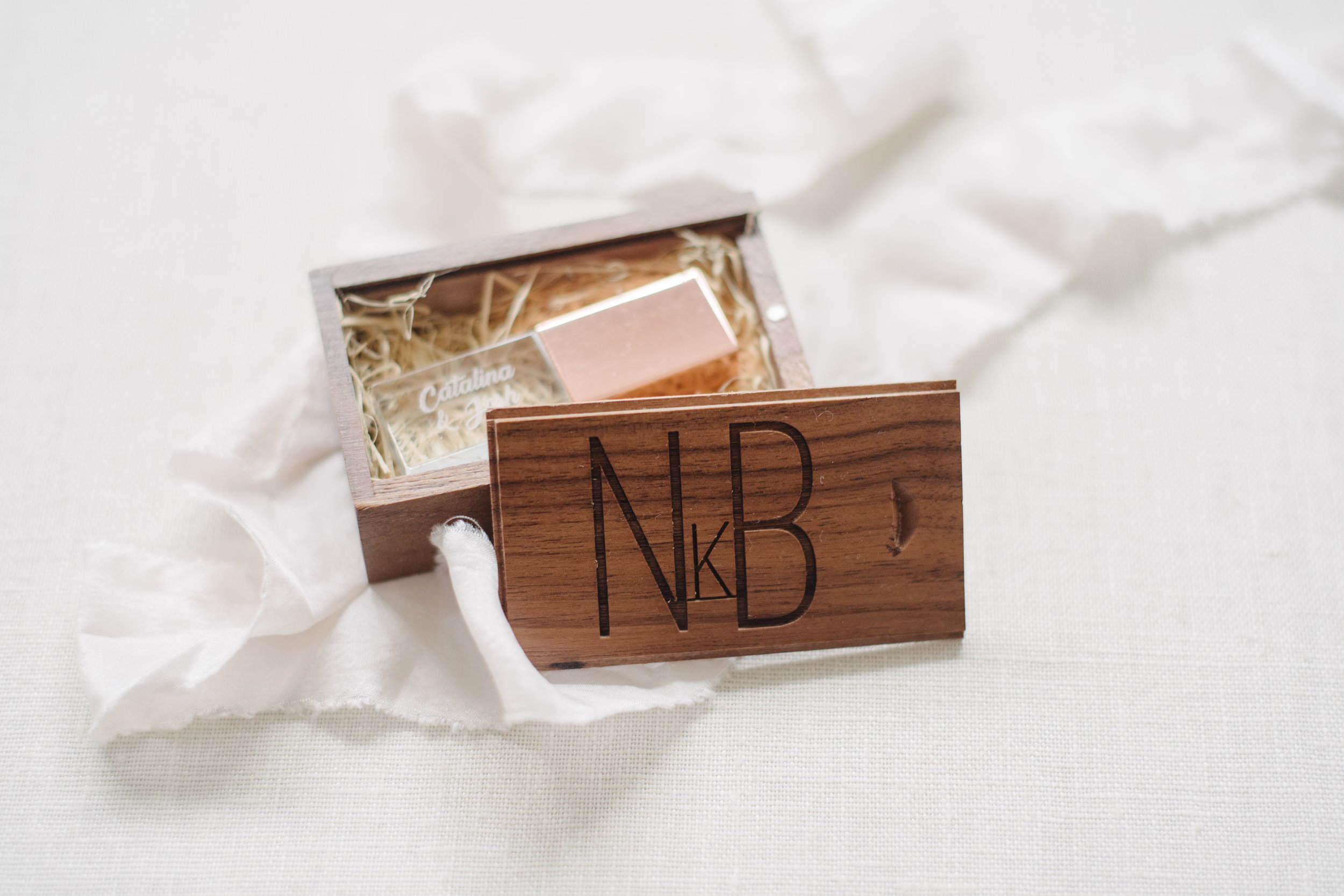 Rose Gold and Acrylic USB with a studio logo branded walnut box
