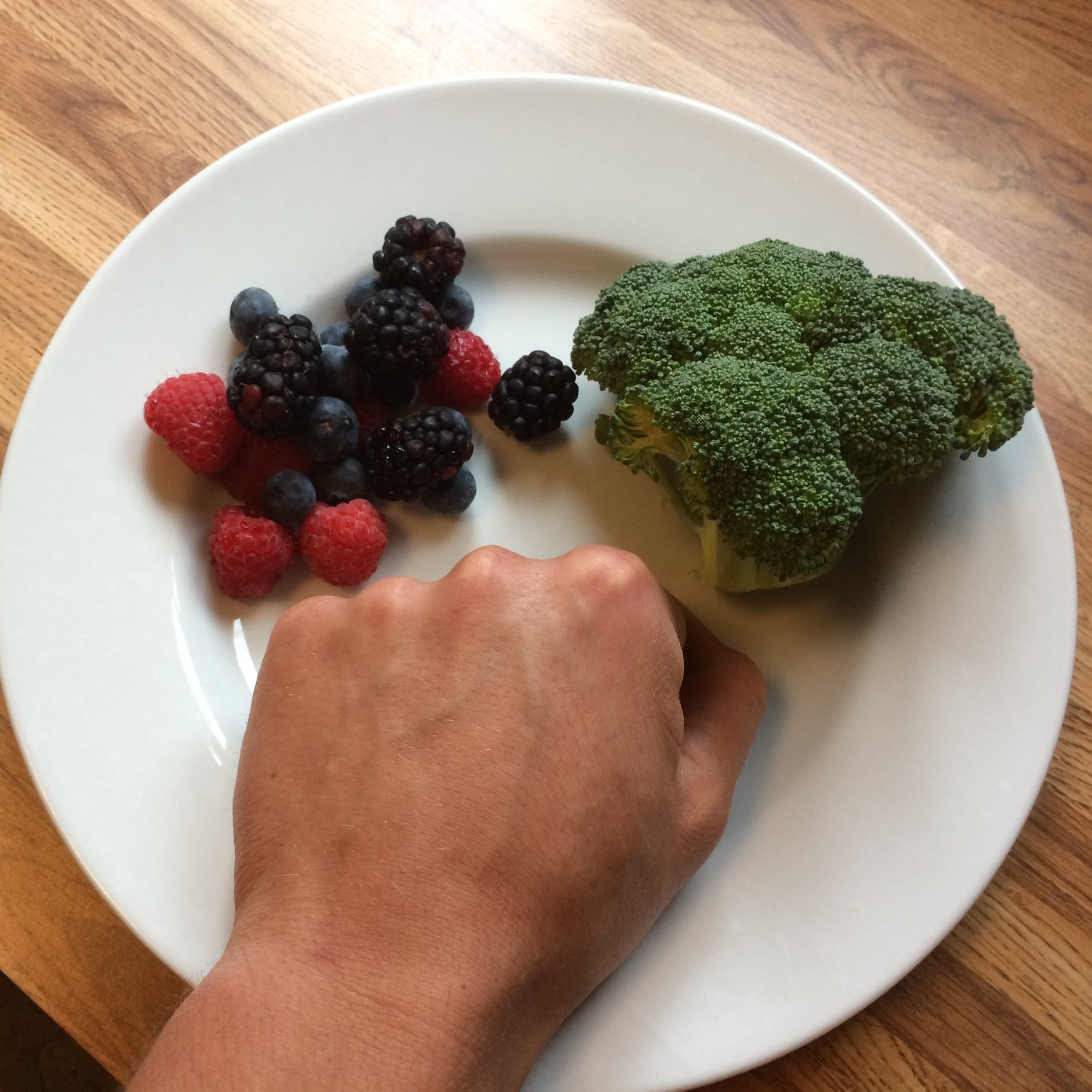 single servings of broccoli and berries