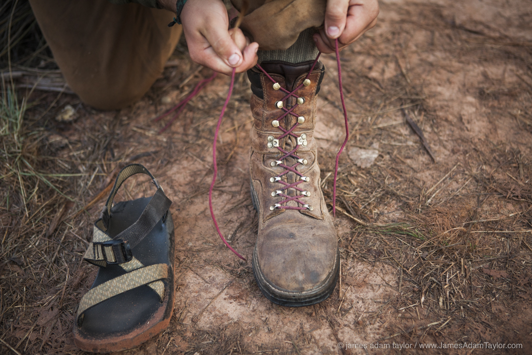 Crew Leader James Shaw laces his boots in preparation for the day.