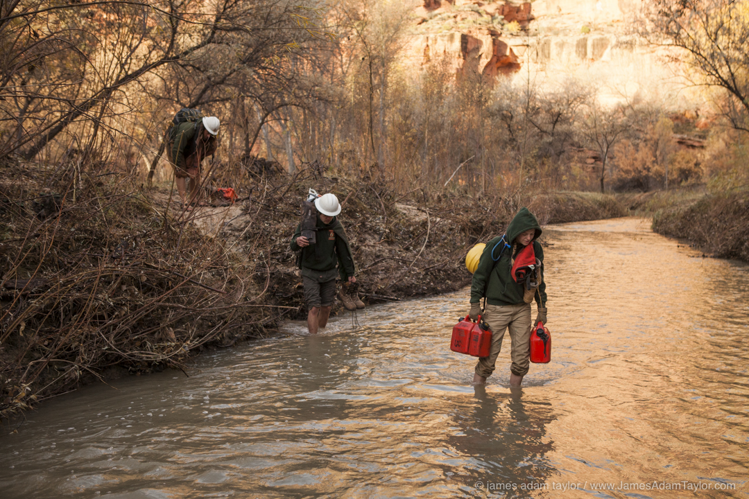 Members of the Boulder B crew cross Boulder Creek on their way to the morning work site.