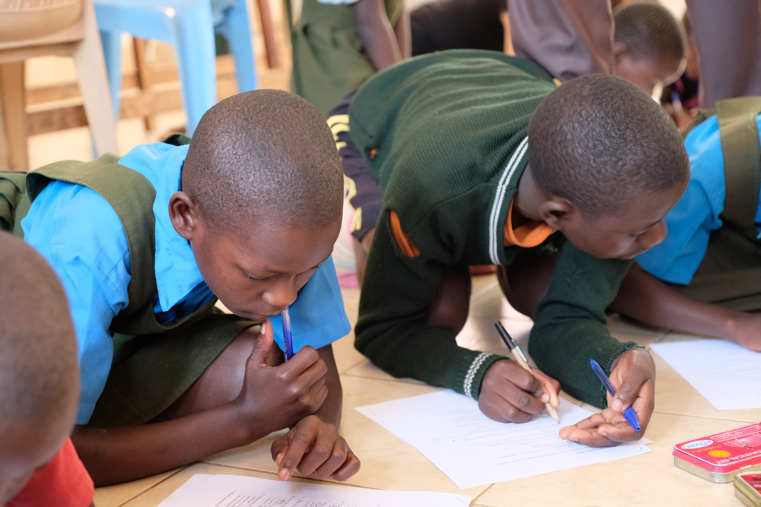 Grade 2 students from Hadassa Primary School filling out a TWSB reading questionnaire.