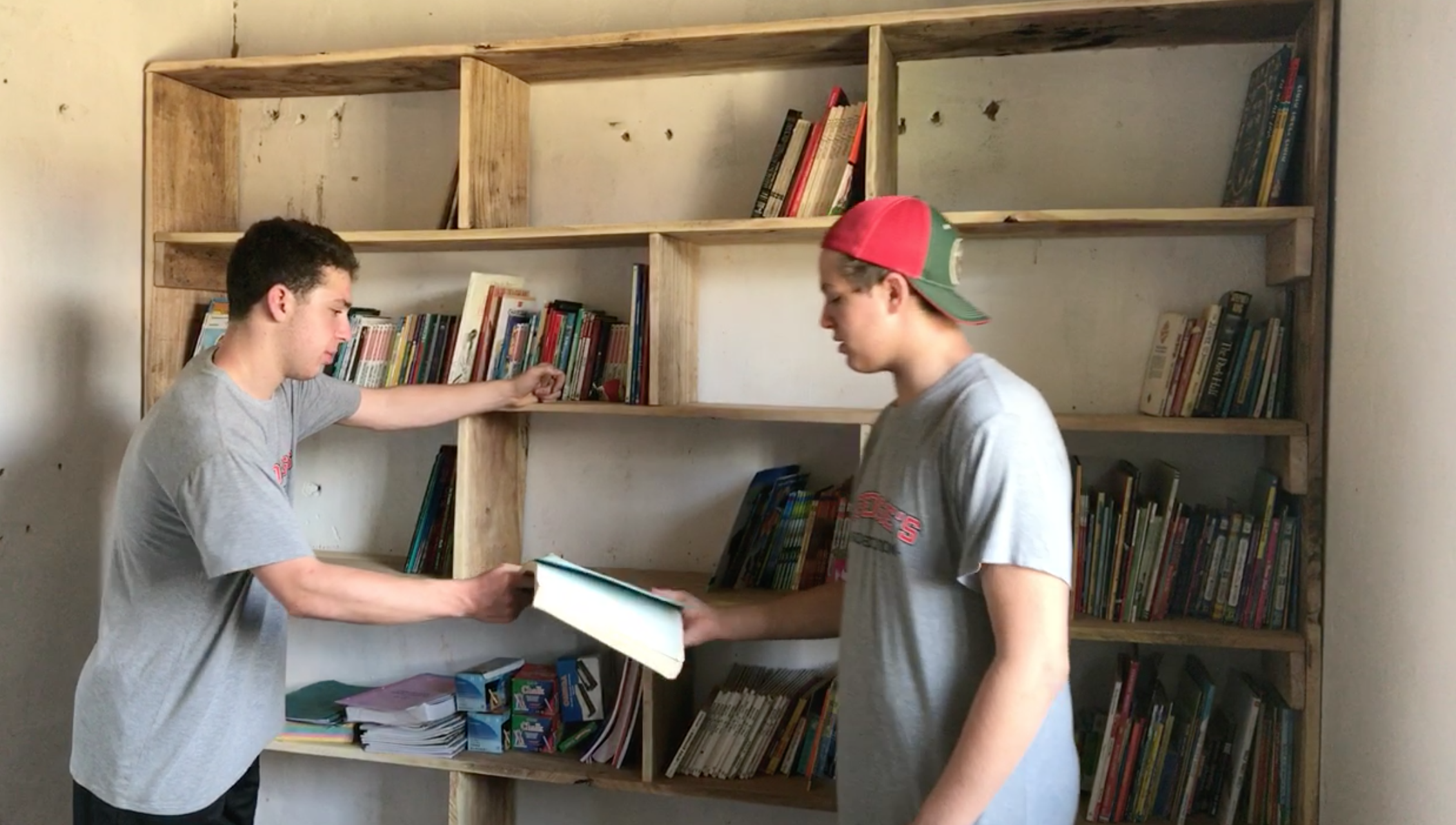 Tyler and Justin helping to organize the new library.