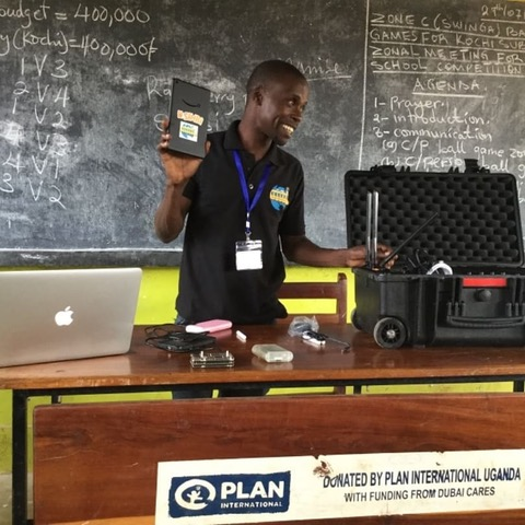 TWSB Uganda Technology Coordinator, Sadati Mulilo. training Alaba Primary School teachers on the resources available in the BrightBox Micro.