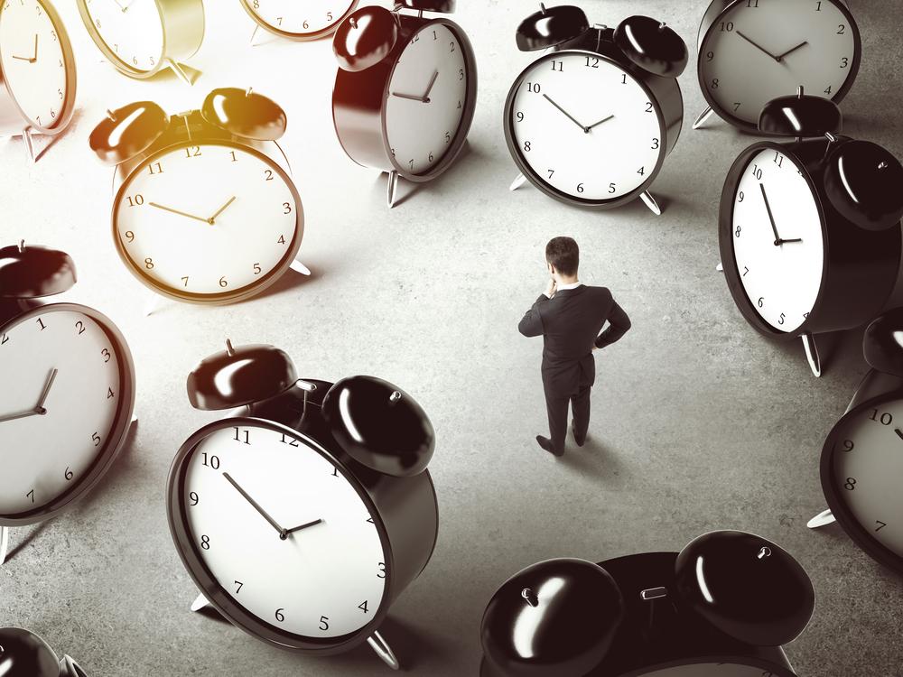 Man surrounded my clocks
