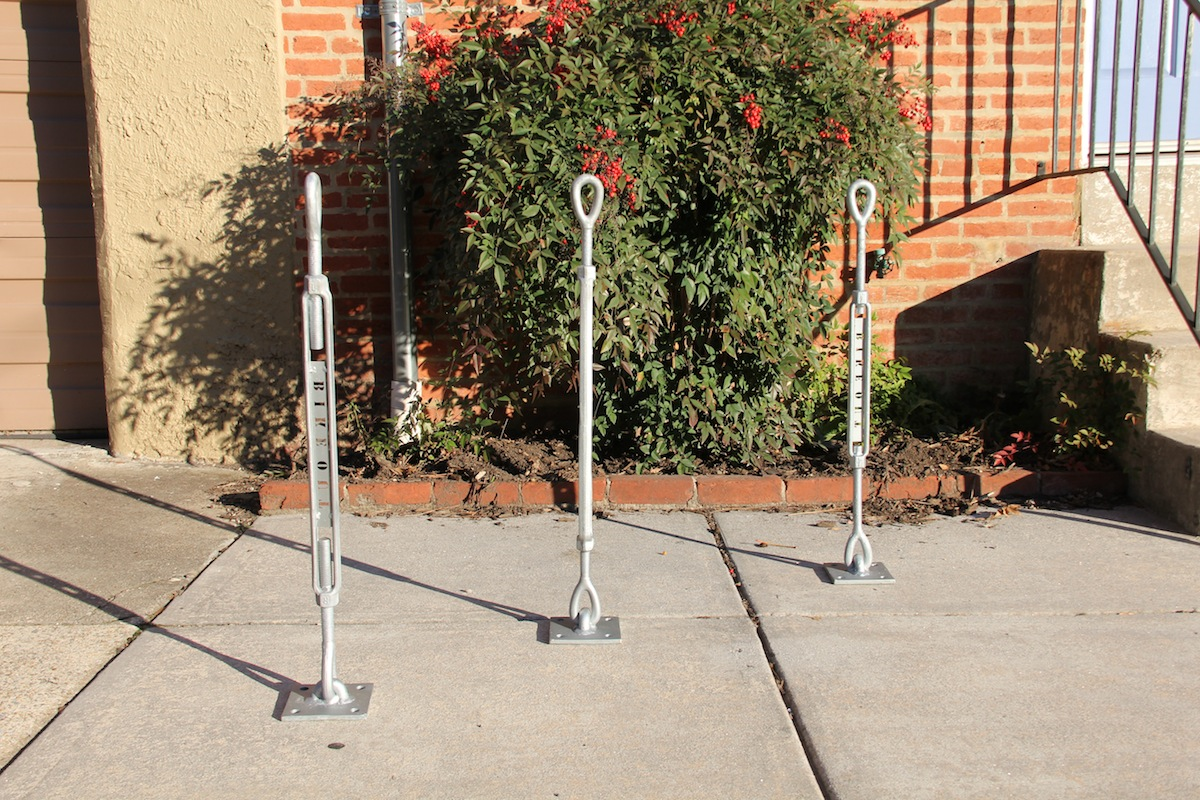 Sidewalk mounted bike station locks and racks can be mounted in group configurations.