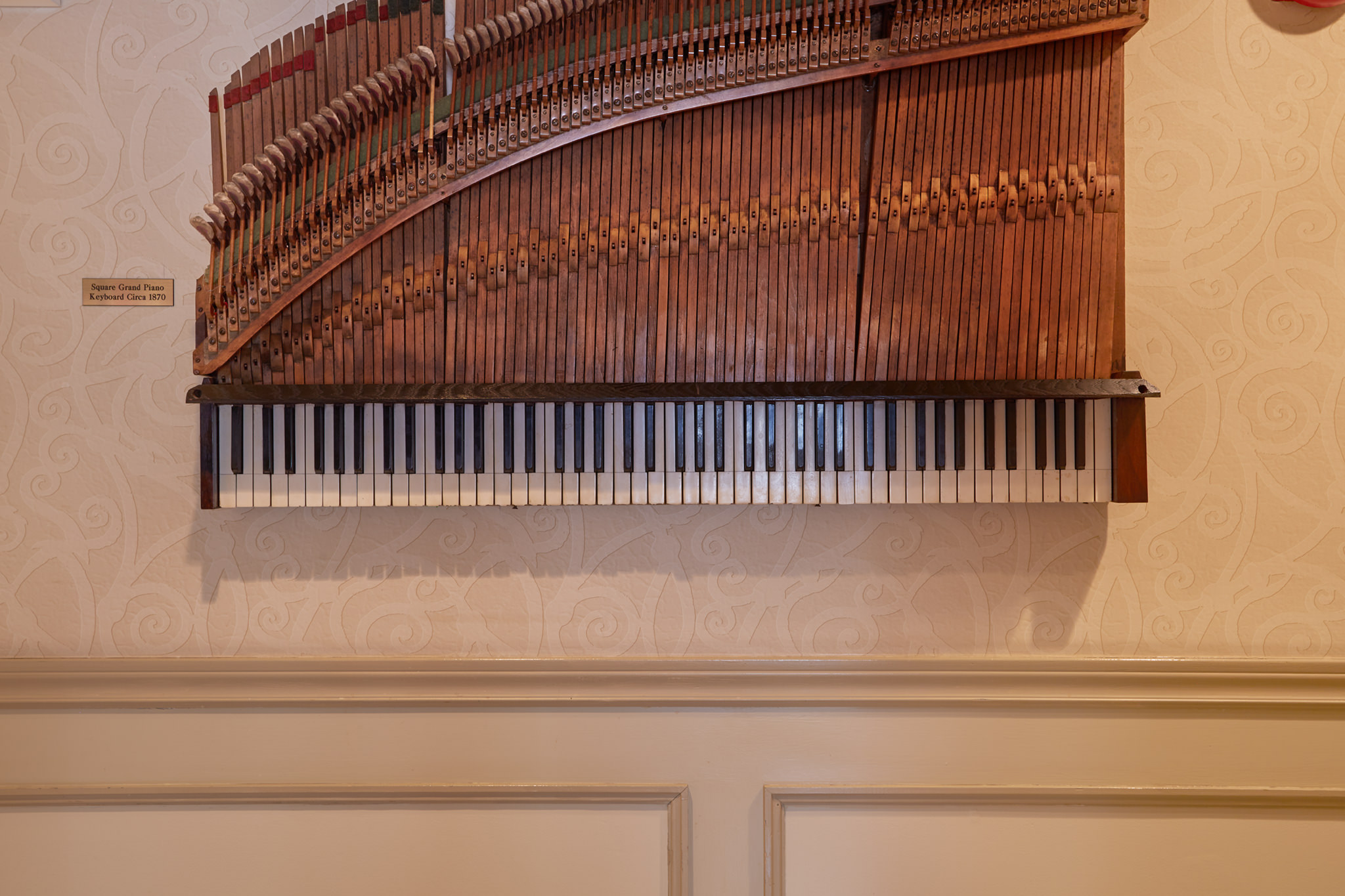1 of 6 Pieces of 1870 Square Grand Piano That Adorn the Lobby Walls