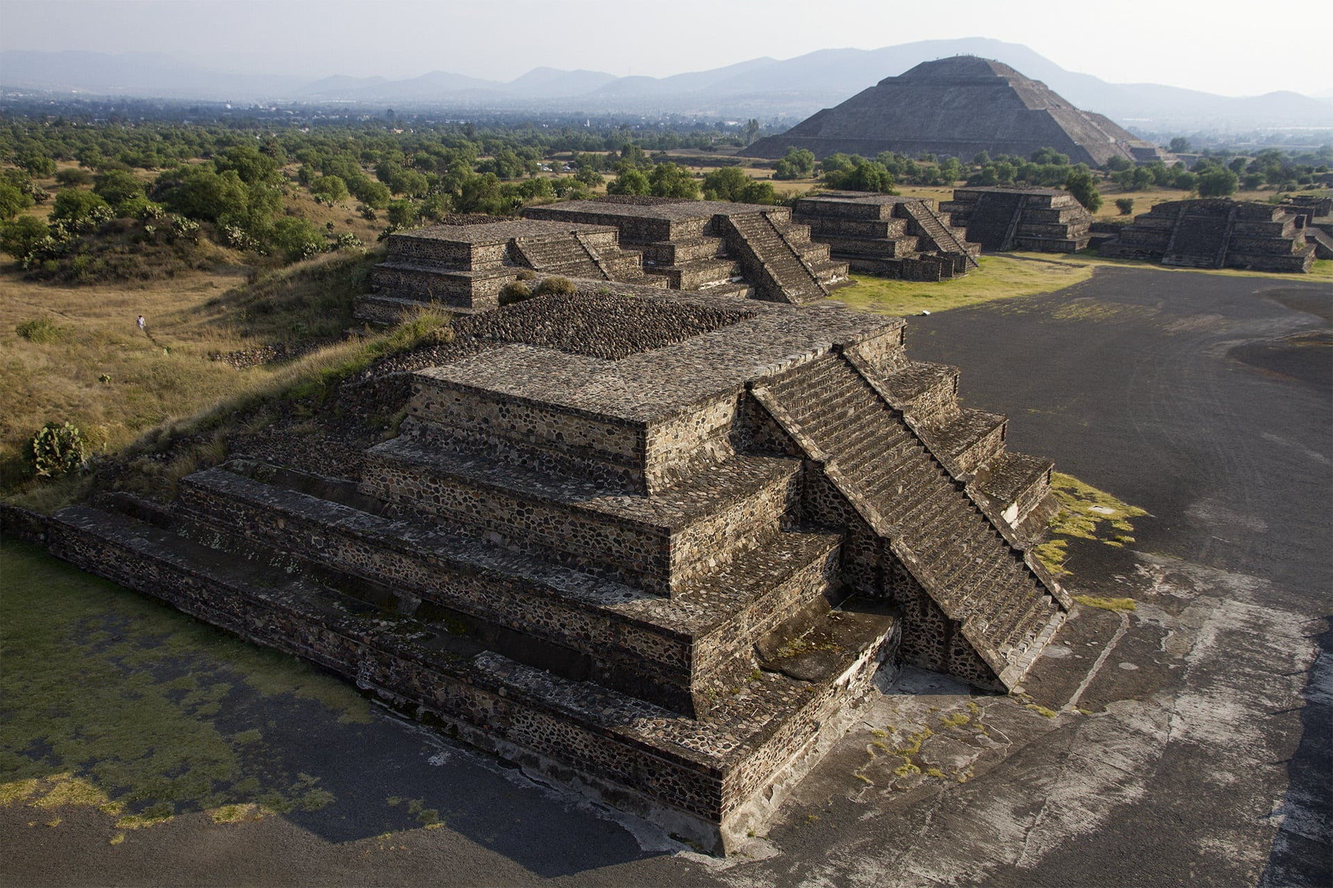 Shadows grow long and streak away from the Mesoamerican pyramids.