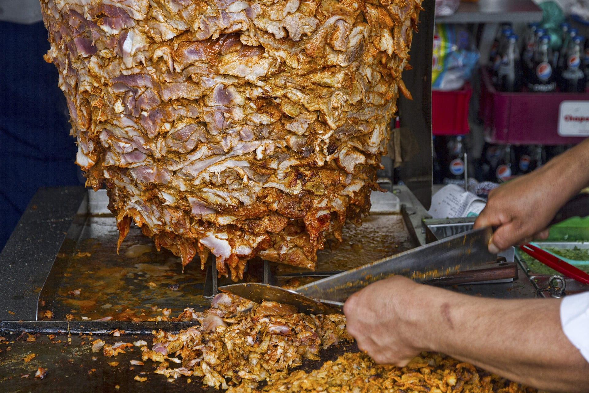 A proven sign of a good lunch spot is to observe the locals. A gathering of businessmen and women looking longingly at a rotating heap of meat is likely not a quarterly financial meeting.  Tacos al pastor  it is.