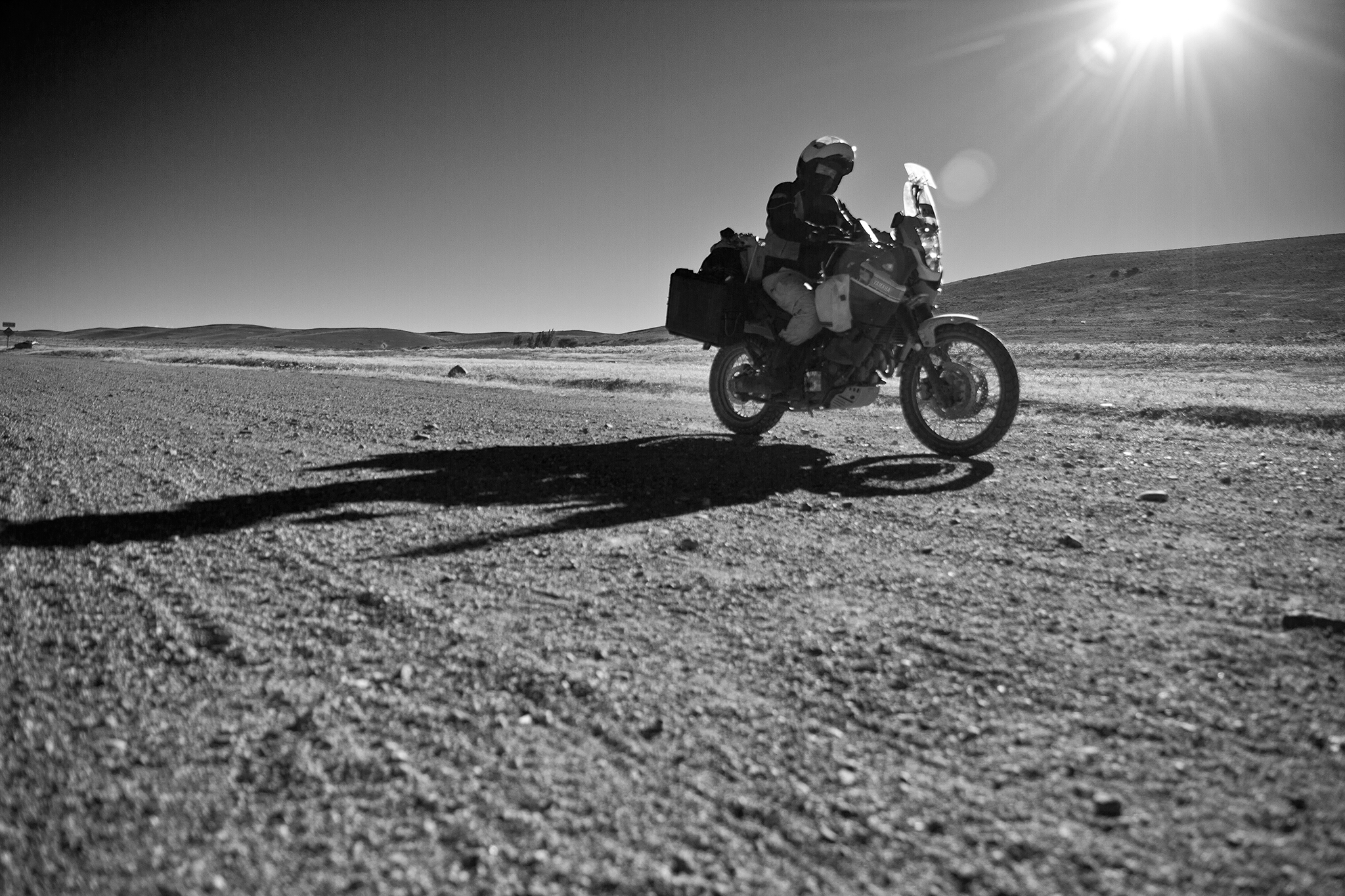 """Although each day of riding offered serious """"helmet time"""" for self-reflection, we spent evenings swapping stories of teenage stupidity, past regrets and far-off dreams. With cuts of meat sizzling next to the glowing coals of an Argentinian  asado , I listened to Dad relive the time he plugged a hemorrhaging crankcase with a piece of gum in the Spanish deserts, 30 years ago. Didier's tales of avalanche rescues as part of a ski patrol unit in the French Alps kept me on the edge of my seat, questioning my own alpine ambitions."""