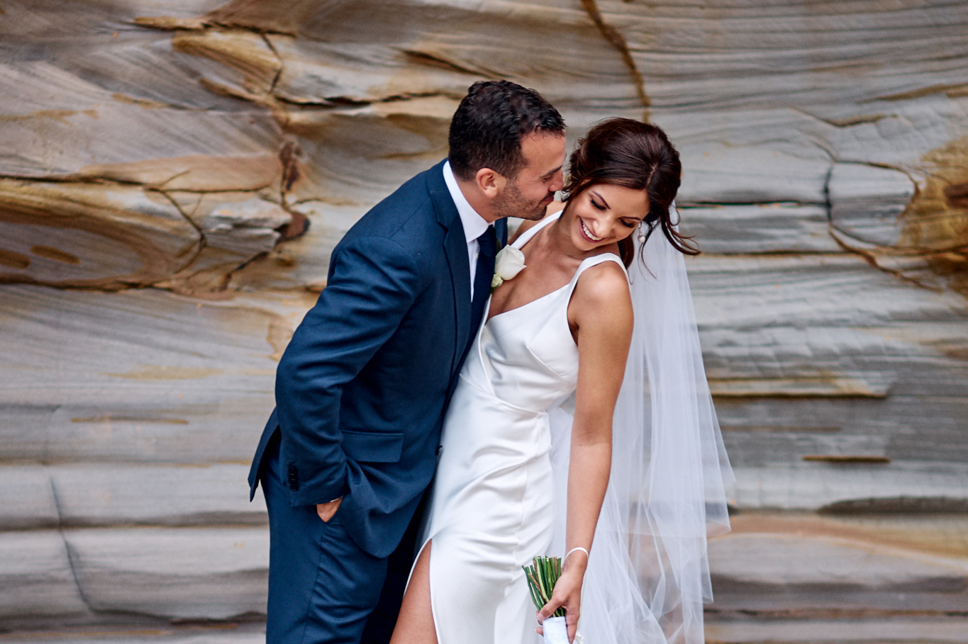 Bride and groom laughing together for portrait on the rocks at Moby Dicks whale beach by Blue Mountains wedding photographer Joshua Witheford