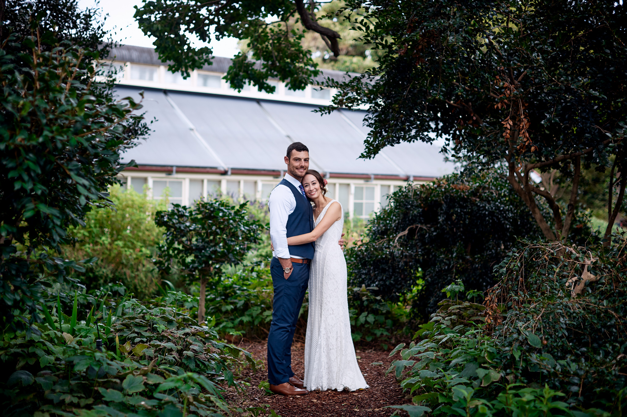 bride and groom hugging in garden Sydney Royal Botanic Gardens by Blue Mountains wedding photographer Joshua Witheford