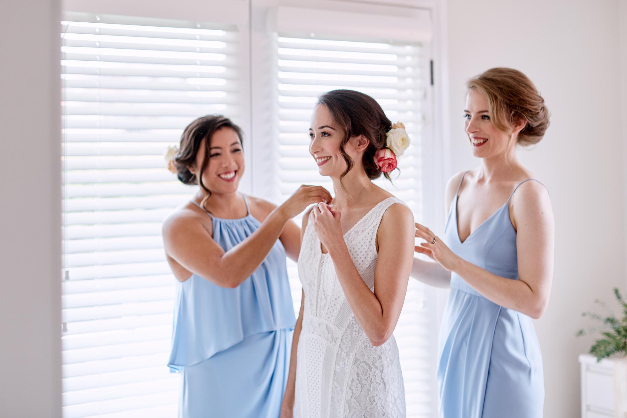 bride putting necklace on.jpg