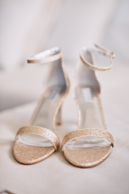 Brides golden wedding shoes