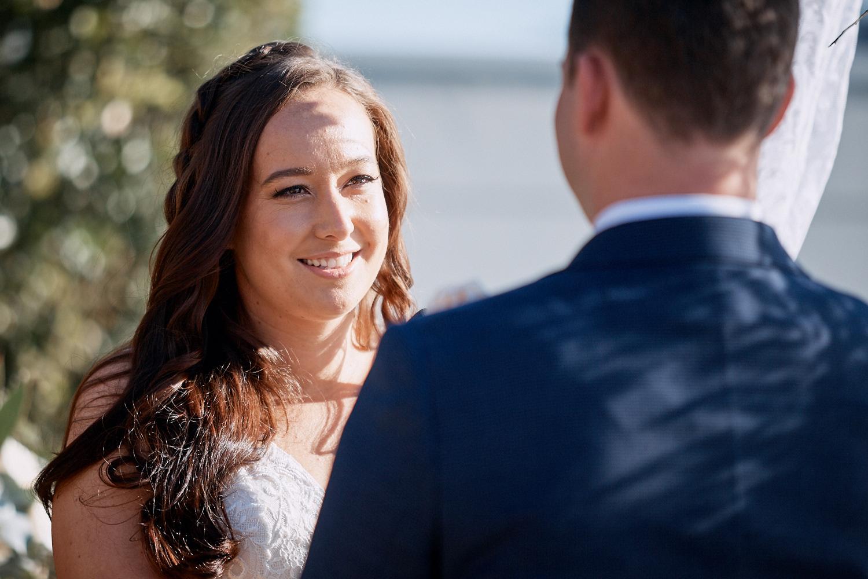 Bride smiling at groom at Lucinda Park wedding
