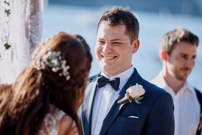 Groom smiling at bride during Lucinda Park wedding