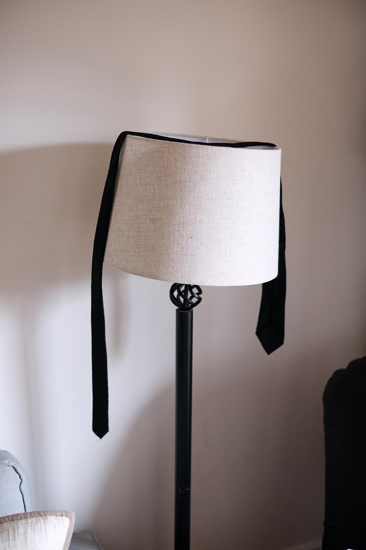 Black tie draped over lamp shade