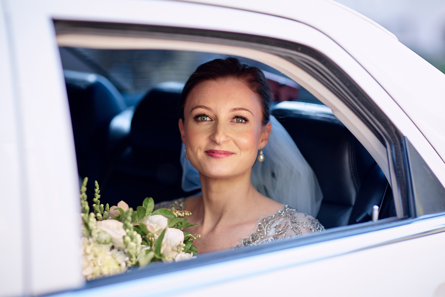 Bride through window of limousine outside of St Marks Anglican Church, Darling Point