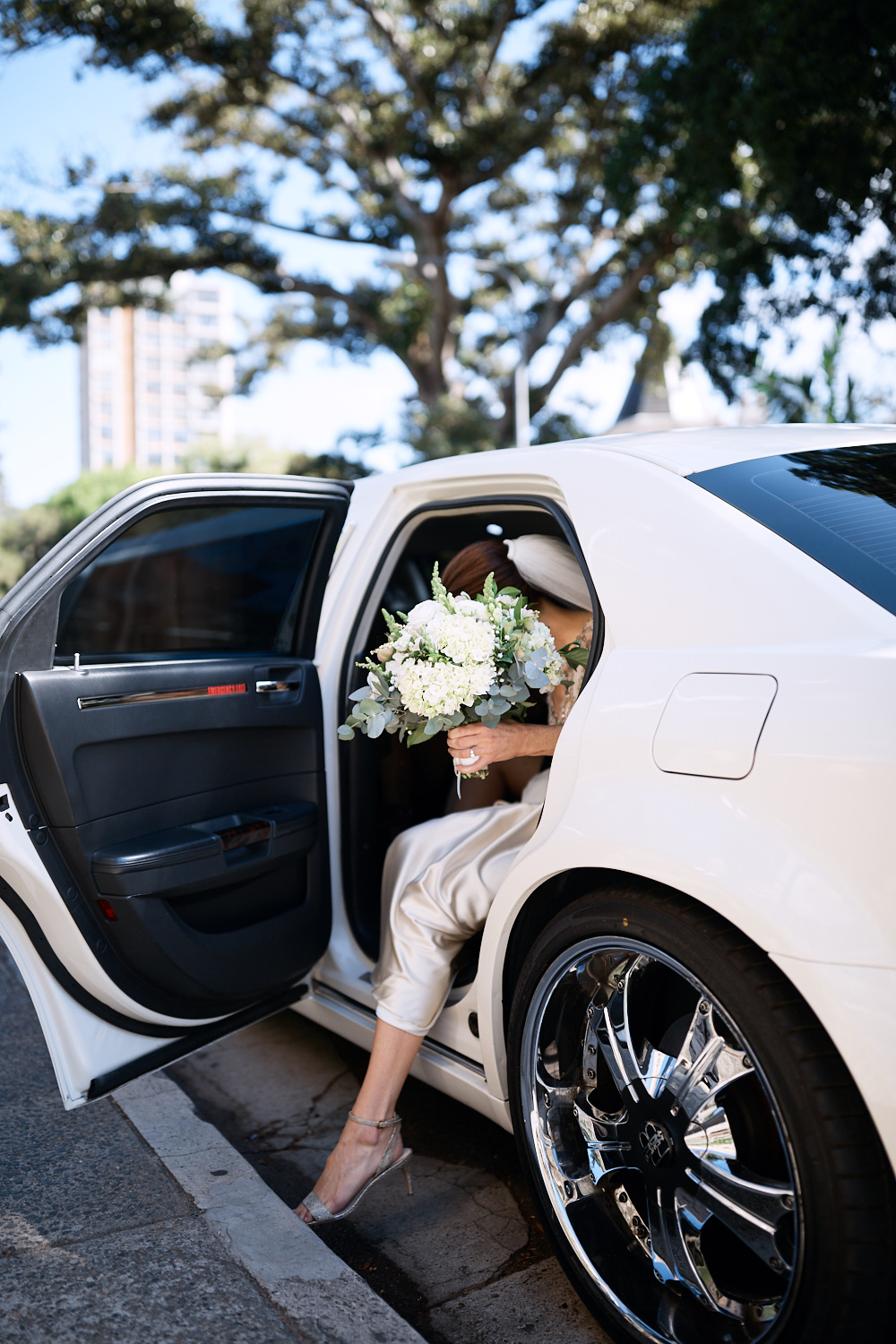Bride exiting limousine at St Marks Anglican Church, Darling Point