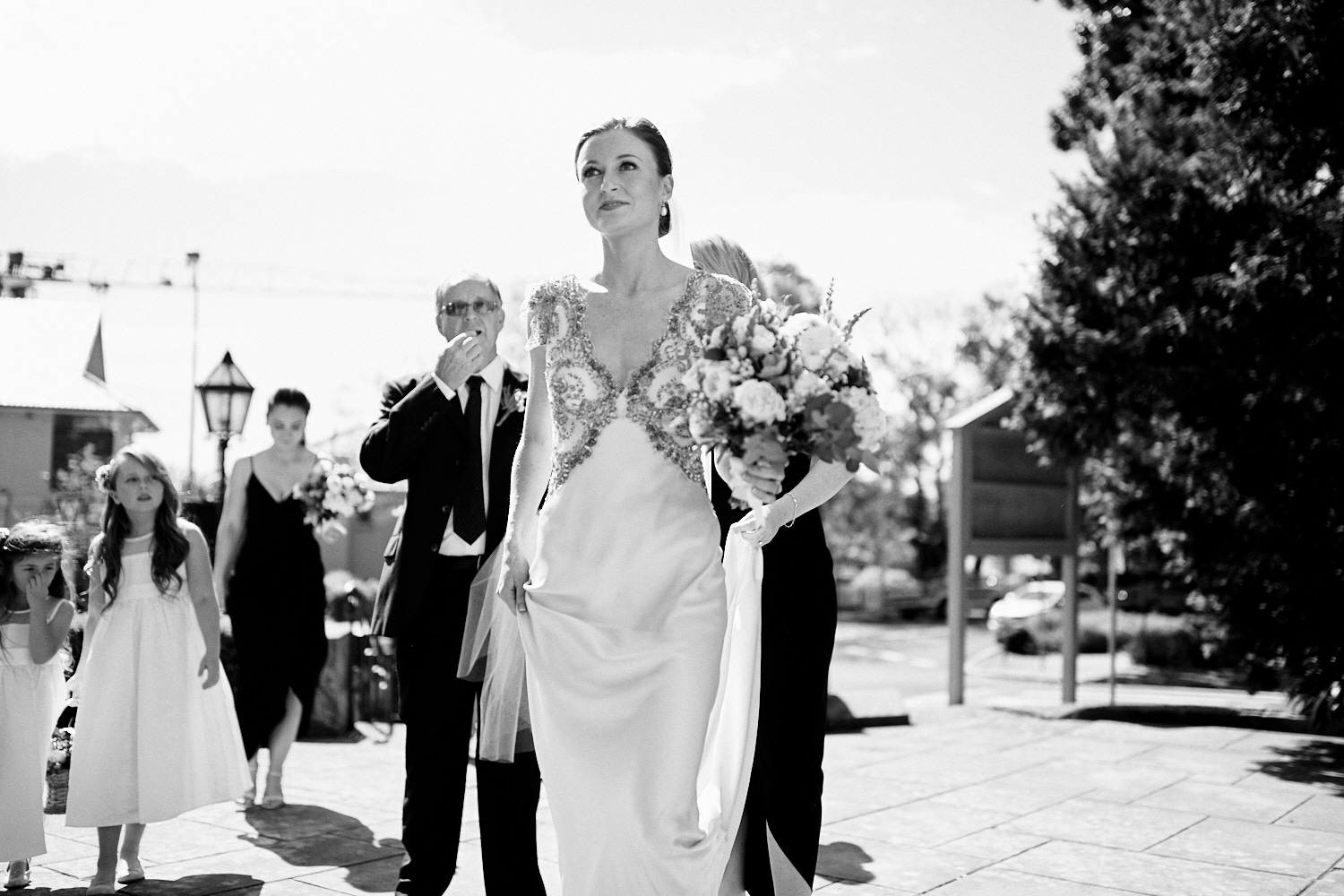 black and white of bride walking into St Marks Anglican Church, Darling Point