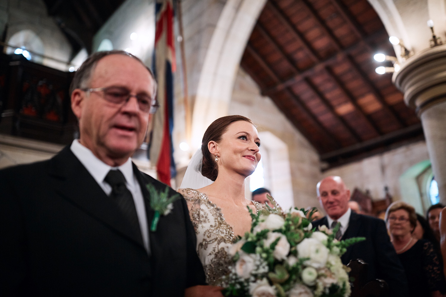 Bride smiling walking down aisle of St Marks Anglican Church, Darling Point