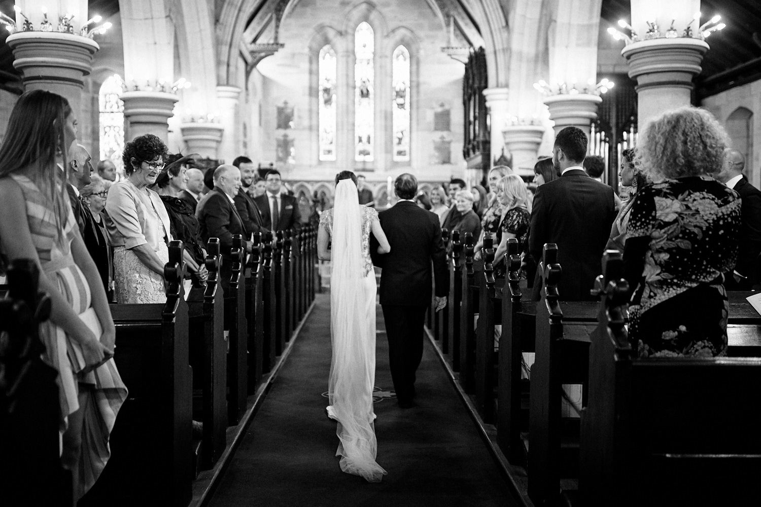 Back of bride and father walking down aisle of St Marks Anglican Church, Darling Point