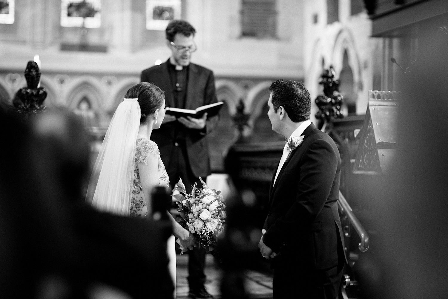 Black and white of couple during wedding ceremony at St Marks Anglican Church, Darling Point