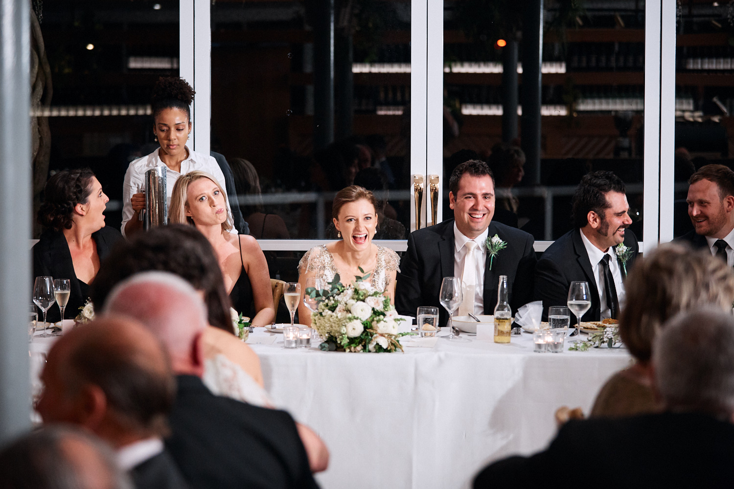 Bride and groom laughing during reception at Centennial Homestead wedding