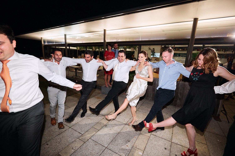 Greek dancing at Centennial Homestead wedding