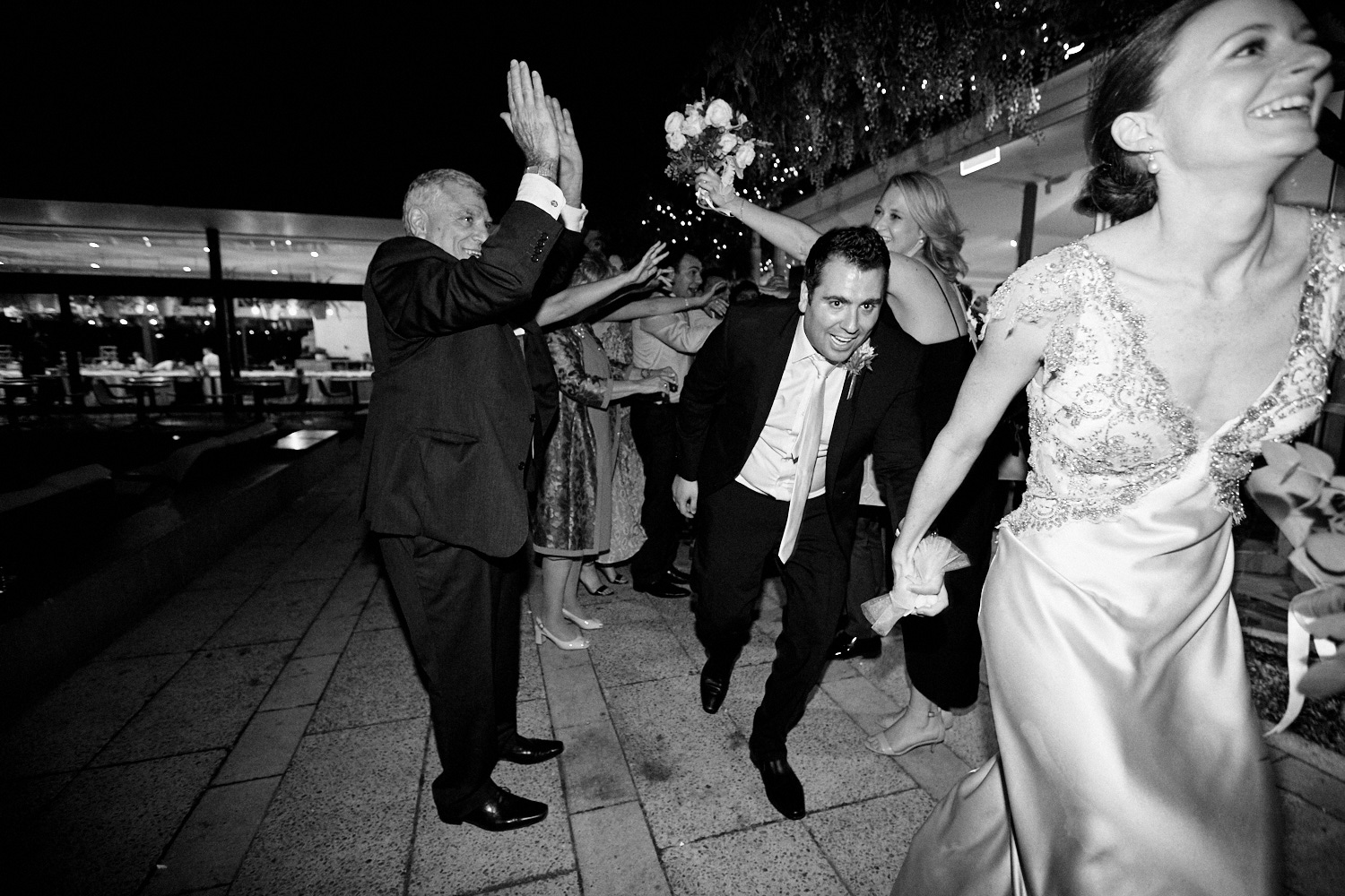 lack and white of groom exiting tunnel at Centennial Homestead wedding