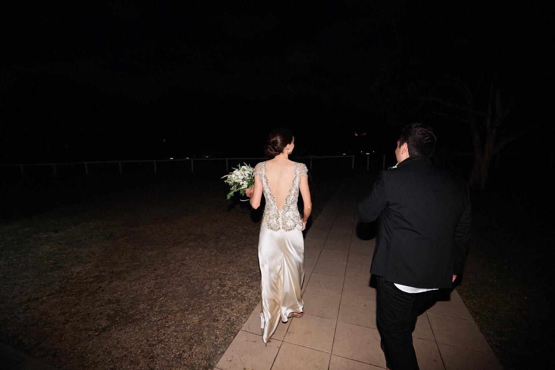 Bride and groom leaving reception at Centennial Homestead wedding